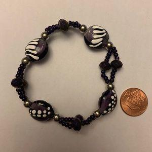 Hand painted one if a kind purple beaded bracelet